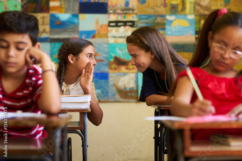 Fotografía  Girls Cheating During Admission Test In Class At School