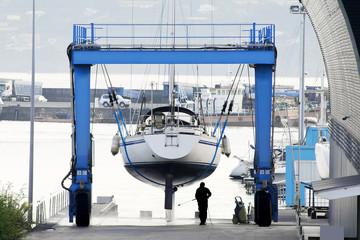 sailboat in shipyard for repair and maintenance in marina port