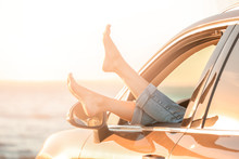 Young Woman Relaxing In Car On River Shore