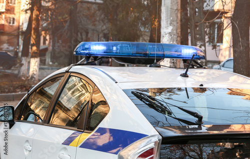 Closeup of police car with lights on the street © Africa Studio