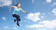 happy sporty young woman jumping in air