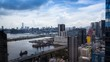 4k Timelapse Top View Of Hong Kong Modern Skyscrapers day whit clouds In Kowloon Bay with boats and vehicles in highway front the port -Dan
