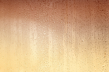 Background with drops on glass, stained yellow-brown. Plenty of space for text.