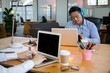 Business executives using laptop at desk