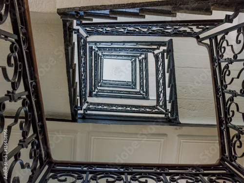 Upside view of a staircase. stair of antique square staircase st