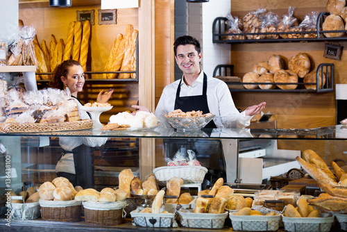 Foto op Plexiglas Bakkerij Portrait of friendly positive smiling couple at bakery display
