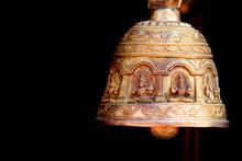 Antique Bell Against Black Background