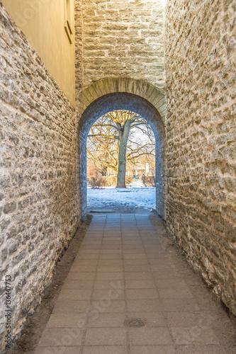 Fényképezés  Narrow stone corridor