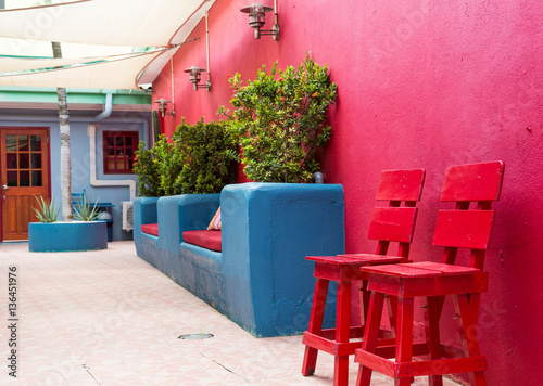 Photo Red Stools on Wall