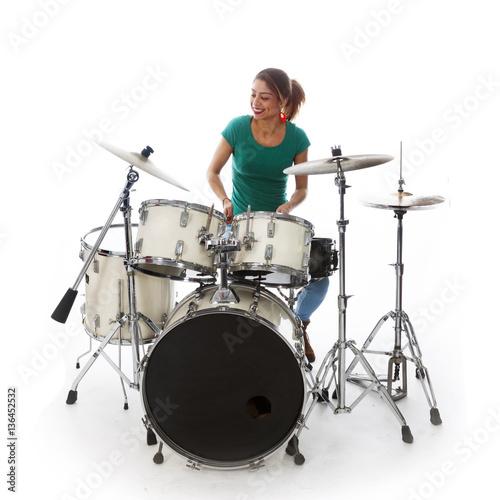 Tablou Canvas brunette brazilian woman plays the drums in studio