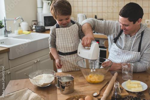 Fototapeta A father and his son cooking obraz na płótnie