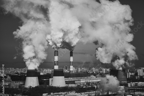 Foto Industrial Smoking chimneys. The destruction of the ozone layer