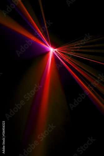 Photo  Laser beam red on a black background