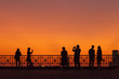 Silhouette people at sunset in big city