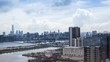 Timelapse Top View of Hong Kong Cityscape day whit clouds, skyline of the city near Kowloon Bay with ships and cars in freeway front the Harbour -Dan