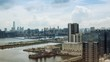 Timelapse Top View Of Hong Kong Modern Skyscrapers day whit clouds In Kowloon Bay with boats and vehicles in highway front the port -Dan