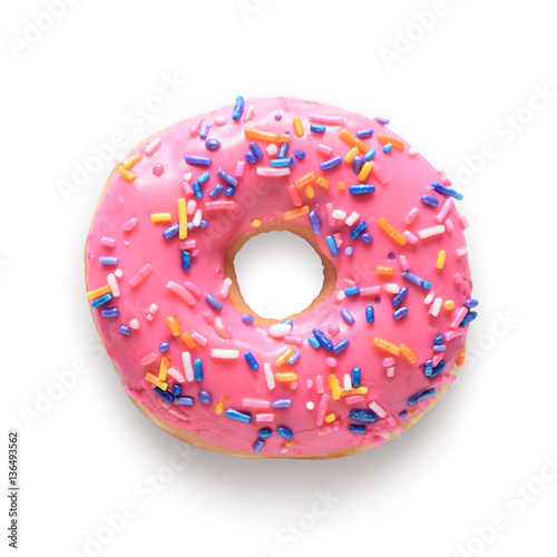 Pink frosted donut with colorful sprinkles isolated on white bac