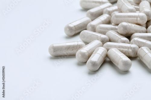 Pile of white capsules probiotic powder inside Obraz na płótnie