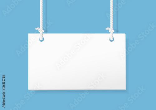 Fotografía  Blank hanging sign on blue background. vector