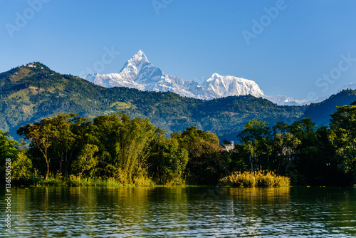 Wall Murals Nepal The Machapuchare (left, 6993m) and Annapurna III (right, 7555m) seen from Phewa Lake in Pokhara, Nepal