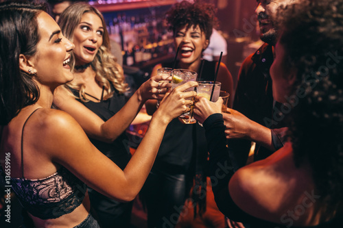 Group of friends partying in a nightclub