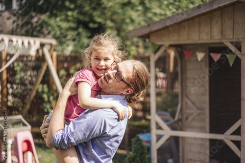 Foto op Plexiglas Dragen Father carrying daughter in garden