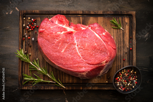 Door stickers Meat A large piece of beef chop on a cutting board. raw meat.