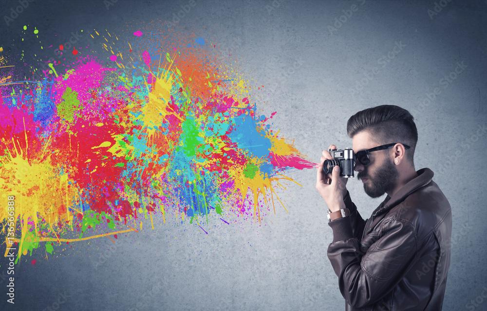 Fototapeta Hipster guy with camera and paint splash - obraz na płótnie