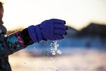Cropped Image Of Girl Playing With Snow