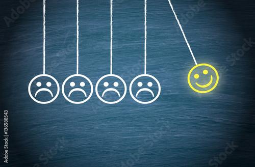 Fotografia  Motivation, Teamwork, Leadership and Coaching Concept - Smiley pendulum on blue