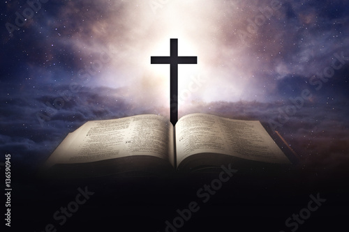 Heaven concept with bible and a cross