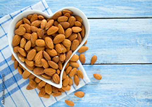 Cuadros en Lienzo almonds on blue wooden surface
