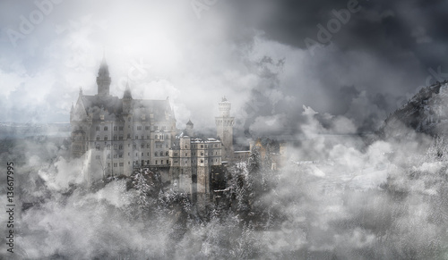 Photo sur Aluminium Chateau General view of the Neuschwanstein castle in the Bavaria Alps from the bridge in fog with clouds