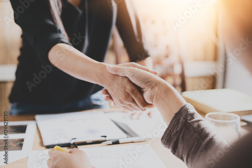 Negotiating business,Image businesswomen handshake,happy with work,business woma Wallpaper Mural