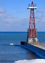 Chicago Lighthouse On Pier That Juts Out Into A Frozen, Icy Lake Michigan.