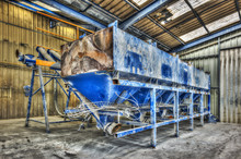 Industrial Blue Hopper In An Abandoned Factory