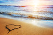 Heart on the sand beach. Romantic composition.