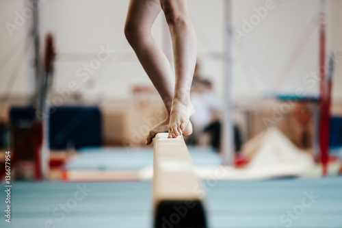 Tuinposter Gymnastiek competition gymnastics exercises on balance beam girl gymnast