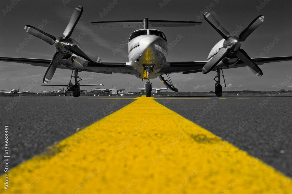 Fototapeta Color key picture of a Piper Cheyenne IV parked on the apron waiting for passengers.