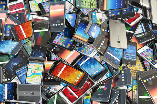 Fototapeta Choose mobile phone. Heap of the different smartphones with diff obraz