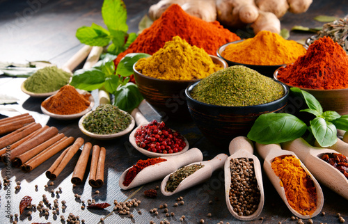 Fototapeta Variety of spices and herbs on kitchen table obraz