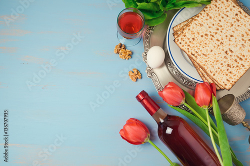 Passover holiday concept seder plate, matzoh and tulip flowers on wooden background Canvas Print