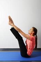 Young Healthy Woman Doing Yoga...