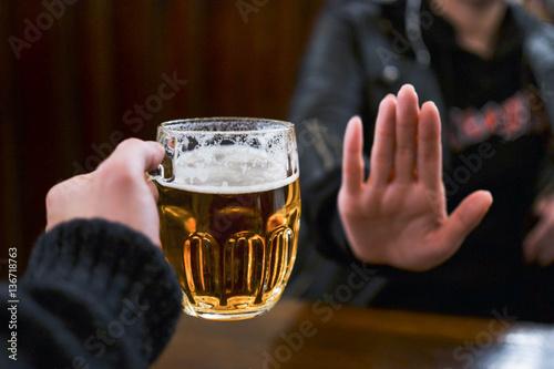 Poster de jardin Bar Girl refusing another glass of beer