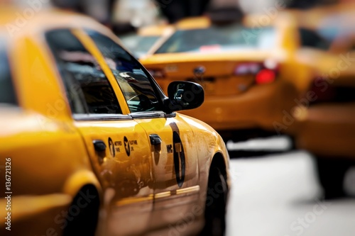 Poster New York TAXI Yellow cab speeds through Times Square in New York, NY, USA.