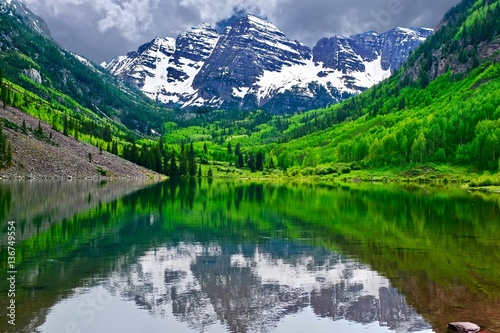 Mountain Peak Reflection In Calm Lake Maroon Bells Near