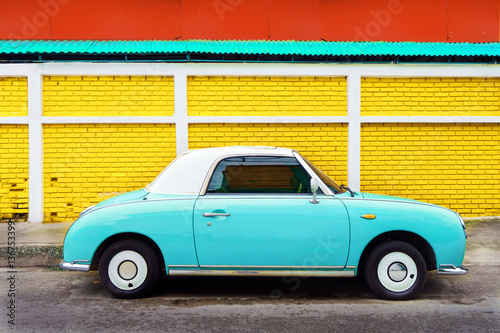 Plakat  Side view of classic car parked on street in city - vintage retro color effect s