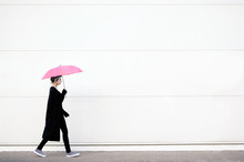 Young Woman Walking With Pink ...