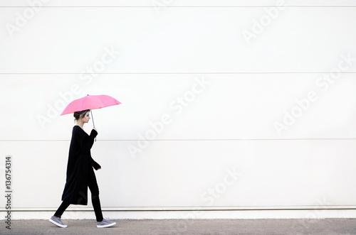 Fotografie, Obraz  Young woman walking with pink umbrella