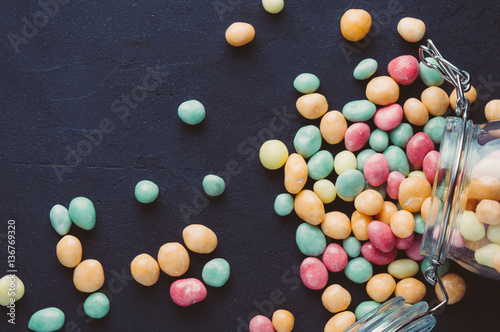 Foto op Aluminium Snoepjes Colorful candies in a jar on a dark background